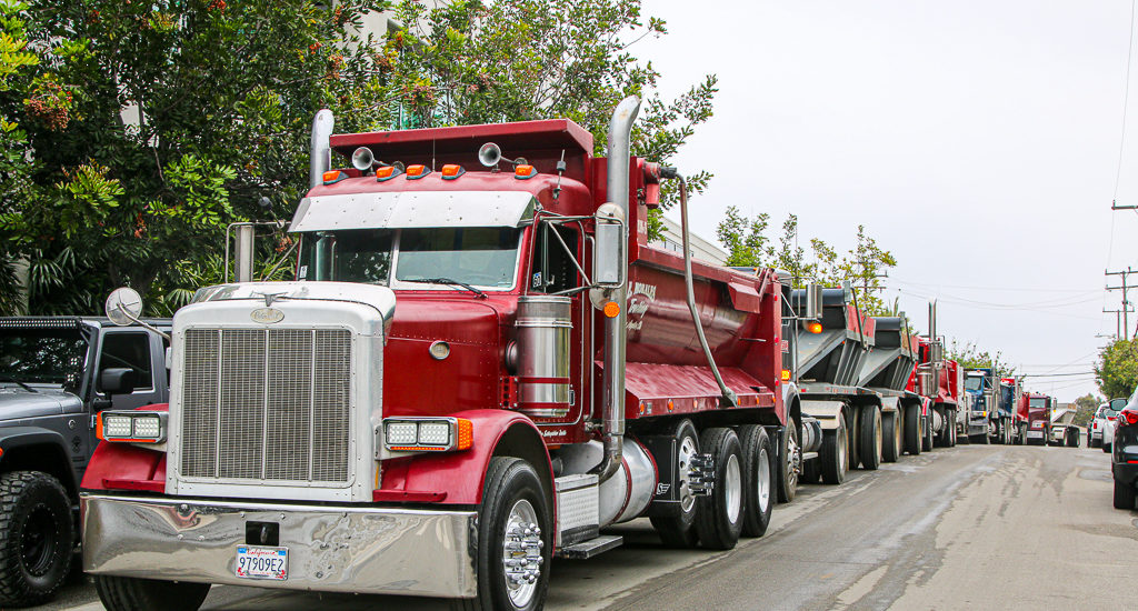 Dumptrucks on parade at Skechers' Manhattan Beach excavation site