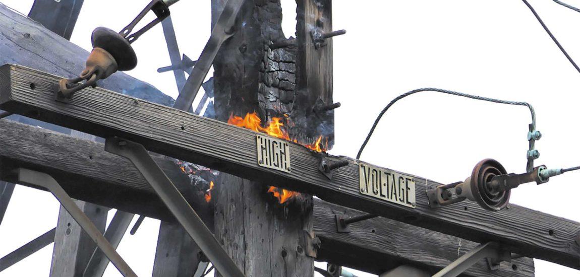 Utility pole fire causes neighborhood power outage