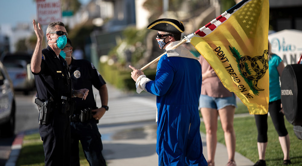 Beach closure protest along Redondo Beach Esplanade can't compete with setting sun