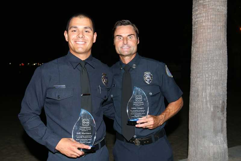 Captain John Greger and Ocean Lifeguard Specialist Jeff Martinez, winners of the Distinguished Service Award.