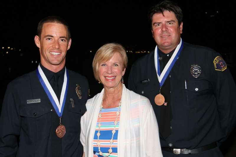Ocean Lifeguard Specialist Chris Maloney and Captain Chris Staffield, winners of the Medal of Valor, with L.A. County Supervisor Janice Han.